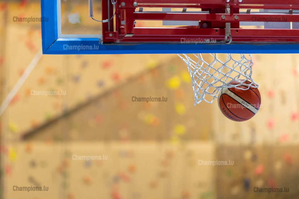 Basketball ball entering hoop